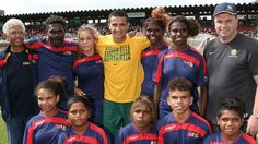 John Moriarty, Tim Cahill & Ange Postecoglou with the kids from Borroloola.