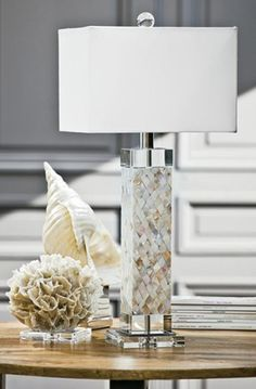 Lamp handcrafted of square-cut slices of alabaster block; color variations will occur. Synthetic silk shade. Uses one 60-watt bulb. Use only wattage specified; higher wattage may discolor the ala…
