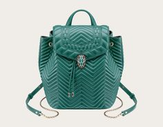 Backpack Serpenti Forever in forest emerald quilted nappa leather and black internal lining. Brass light gold plated hardware and snake head closure in matte black and forest emerald enamel, with eyes in black onyx. Stock Code: 286973