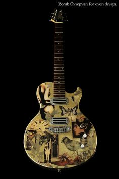 Mixed-media artwork on functioning electric guitar.  Created by Erin Fahey and Eric Cooke of evendesign
