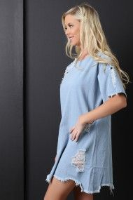 FREE SH & Easy Returns! Shop Distressed Denim Raw Edge Hem Shift Dress featuring a denim fabrication, distressed accents, elbow length sleeves, round neckline, shift cut, and a raw edge hem.