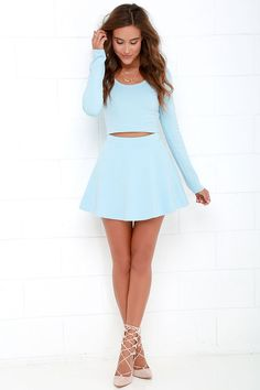 """On your way out of this atmosphere, make sure you grab the Stratosphere Light Blue Two-Piece Skater Dress! Medium-weight stretch knit fabric lays across a fitted and cropped long sleeve bodice with a scoop neckline and darting. Matching skater skirt begins at a banded waist before flaring to a mini-length hem. Top is unlined; skirt is lined. Small top measures 15.5"""" long. Small bottom measures 14.5"""" long. 67% Viscose, 28% Nylon, 5% Spandex. Hand Wash Cold."""