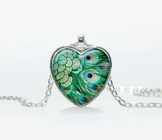 The pendant is 1 inch (25mm x 25mm) image under domed glass cabochons. The chain is 24. The pendant comes in beautiful organza bag. More Heart