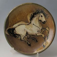 Image result for pottery platter with horses imprinted
