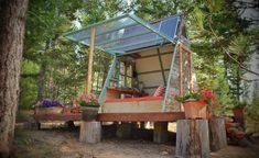 Anyone dreaming of building their own affordable tiny cabin should check out this solar-powered cozy retreat. A Frame Cabin, A Frame House, Tiny Cabins, Tiny House Cabin, Dry Cabin, Guest Cabin, Montana Living, Little Cabin, Tiny House Movement