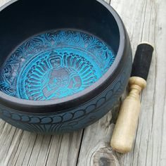 Each of these beautifully designed round sided singing bowls includes a wooden dowel-striker. The bowls interior features the healing image of the Medicine Buddha and a vibrant blue sand finish comple