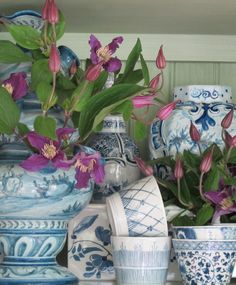Pink tulips sprouting from a mélange of blue and white porcelain ~ Charlotte Moss