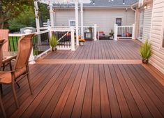 Picture-framed deck by Fiberon composite decking. Like this reddish brown for back deck. Deck Stain Colors, Deck Colors, Trex Decking Colors, Trex Composite Decking, Patio Deck Designs, Patio Design, Deck Flooring, House Deck, Farm House