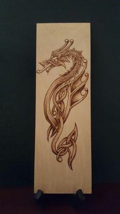 Woodburned celtic dragon pyrography