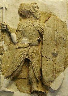 A Parthian stucco relief of an infantryman, from the walls of Zahhak Castle, East Azarbaijan Province, Iran