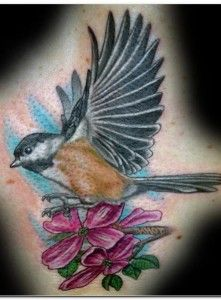 I'm taking the flowers out, and having this face my cardinal tattoo. Eventually there will be a banner between the two birds with my grandmother's name