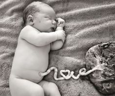 "A photographer in Australia has taken a viral photo of a newborn baby boy with his umbilical cord still attached, spelling out the word ""love."" Keep reading for the full story!"