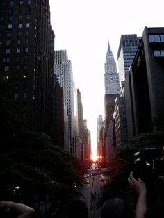 manhattanhenge in new york one of the two days of the year when the setting sun lines up exactly with the citys east west streets
