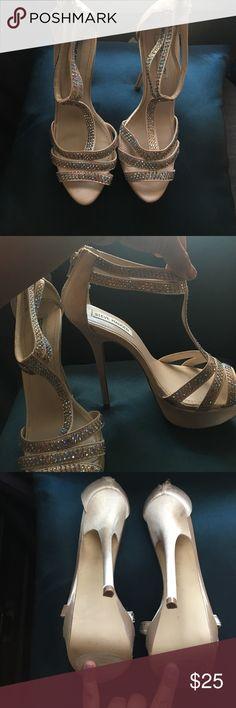 "Steve Madden t-strap heels Light cream colored  iridescent heeled t-strap heels. 4"" size 7.5. Never been worn. Steve Madden Shoes Heels"