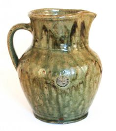 Attributed to Thomas Chandler, Edgefield District,  South Carolina. circa 1845. Very fine and runny  alkaline glazed pitcher with well-forme...