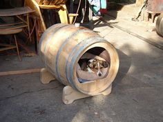 "re-claimed wine barrel dog house.  appox. 30"" deep and 23"" wide in the middle.  $350. 253-886-2970"