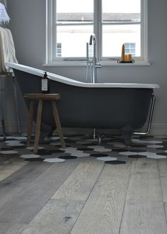 A nice trend. Tiles inserted in a wooden floor. Craftsmanship is essential in this.