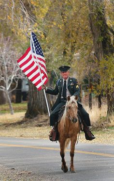 My Uncle Gordy ~ Vietnam veteran Gordon Beals rides his horse down Pine Canyon Road Wednesday morning. Beals has ridden his horse with a flag every July 4 and 24, Memorial Day and Veterans Day