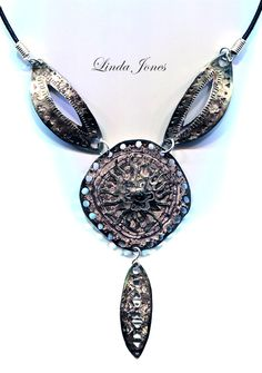 From my Tribal Aritfacts collection ... nickel etched pendant