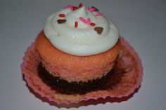 Brownie mix, strawberry cake mix, and vanilla icing cupcakes.