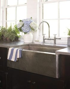 farm sink - stainless steel & hydrangeas in the kitchen to top it off! perfect