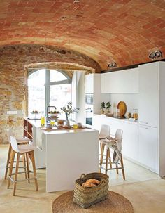 The Arched Brick Ceilings And Stone Wall Gives This All White Kitchen A  Rustic Feel