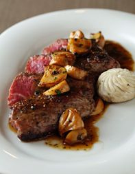 The tender hangar steak meat gets a subtle kick from the green peppercorns, while silken mushrooms and Worcestershire umami-fy the rich, buttery sauce. Some classics never die.