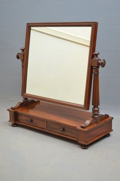 Early Victorian mahogany toilet mirror, having rectangular mirror supported on elegant fluted columns terminating in figured mahogany base with 2 jewellery drawers, raise on bun feet. All in wonderful condition, ready to place at Furniture Showroom, Home Decor Furniture, Wood Furniture, Antique Furniture, Diwan Furniture, Furniture Makers, Dressing Table Design, Dressing Table Mirror, Stand Up Mirror