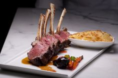 Slowly Roasted Rack of Australian Lamb, Ginger Lamb Juice, Candied Baby Vegetables, and Scalloped Potato Gratin