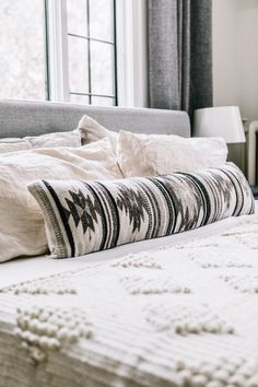 Inspired by the geometric patterns used by the Zapotec tribes of the Oaxaca region, this lumbar pillow's structural designs and black and white color scheme add a contemporary style update to your bed or couch.