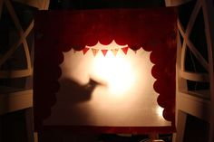 DIY Shadow Puppet Theatre- All you need is a flashlight and a puppeteer or two and you're ready for a performance.