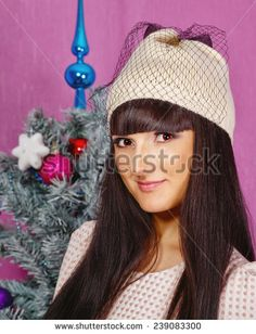 Portrait of young cute girl near the Christmas tree #PinitBuyit @shutterstock