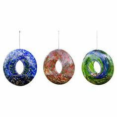 "$68 Add a pop of whimsy to your porch or garden with this colorful glass bird feeder. Featuring a circular silhouette and swirling palette, this design brings harmonious chirps to your backyard.  Product: Set of 3 birdfeedersConstruction Material: GlassColor: MultiFeatures: Circular silhouetteDimensions: 9"" Diameter x 3.5"" D"