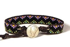 Americana Purple Mountains Mercury A brand new Americana bead loom bracelet for your viewing today! This one is not quite as loud and busy as my typical Americanas; sometimes they are born a little different. Built on naturally dyed black USA leather, I wove rows of purple and olive