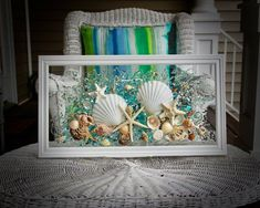 This Sea Glass Art is a beautiful piece that is ready to great to hang on a wall or a window! Any beach lover would treasure this piece forever. The shells are bonded onto the glass with resin. The simple classic frame measures approximately 22 x 12, and is pure white in color. Among the Bathroom Wall Art, Bathroom Beach, Blue Wall Decor, Heart Wall Art, Nautical Bathrooms, Sea Glass Art, Window Art, Beach House Decor, Beach Art