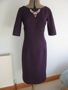 This is my TNT dress pattern, Vogue 2401 (now out of print) in an aubergine crepe.  Lengthened bodice as usual (and hemline).
