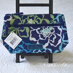 "{Vera Bradley} Lighten Up Travel Cosmetic Bag This is not your typical quilted fabric from Vera Bradley!  With a zip top closure, and separate  front zip pocket that is perfect for makeup brushes there is plenty of room to house your favorite cosmetics. Vera Bradley logo lining easily wipes clean and the lightweight, durable and water-resistant polyester won't soak up all the water on your bathroom counter! Will stand nicely on its solid base. Katalina Blues pattern.  9 ¾"" W x 6 ½"" H x 3 ½""…"