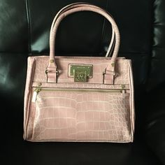 Fun & Flirty HP!!Anne Klein Bag Fun & Flirty HP✨Lightly used pink croc embossed faux leather handbag. Front zipper pocket, magnetic pocket on the back. Interior zip compartment, zip pocket & 2 slip pockets. 13in across & 10in deep. Anne Klein Bags Satchels