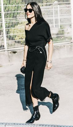 A one-shoulder midi dress is paired with a rope belt, cowboy boots, and black accessories