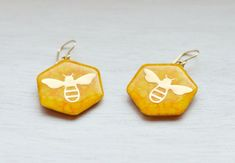 Yellow and Gold Honeybee Dangle Earrings Geometric Hexagon Ocean Jewelry, Summer Jewelry, Leaf Earrings, Dangle Earrings, Metallic Gold Color, White Jewelry Box, Insect Jewelry, Bee Design, Brooches Handmade