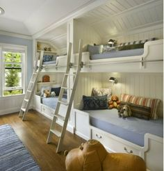 Bunk Beds-I like the 4 on one wall with lights, white wood, and library ladders.