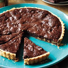 Also a Thanksgiving dessert possibility. Would just need to find  a way to make the crust gluten free... >> Chocolate Walnut Tart | MyRecipes.com