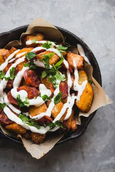 """medium baking potatoes, peeled and diced into 1"""" cubes Canola or Vegetable oil sea salt 1/2 cup The TAPAS Sauces from Spain Mojo Picón Pepper and Tomato Hot Sauce (Or homemade bravas sauce) 4 oz dried chorizo, thinly sliced 2 eggs, fried Pinch of smoked paprika for serving Flat leaf parsley for serving"""