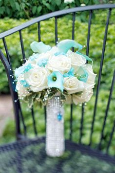 Bridal bouquet of white roses and Tiffany Blue mini calla lilies