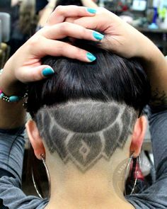 Another undercut design for my girl http://www.facebook.com/rorrothebarber…