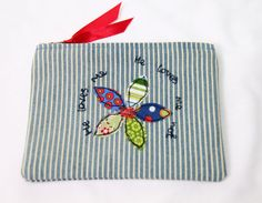 Applique and freestyle machine embroidery purse / make up pouch