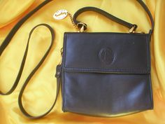 Faigen leather cross body bag with removable strap to become a single strap handbag.