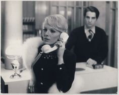 Delphine Seyrig and Jean-Pierre Leaud in Francois Truffaut's Baisers Volés (1968)