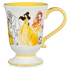 Art of Belle Mug   Disney Store The <i>Beauty and the Beast</i> heroine has been reimagined in a collage of different designs which circle this ceramic cup. Part of our <i>Art of Belle</i> Collection, it features a yellow handle with coordinating interior.