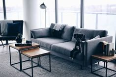 Minimal apartment, interior inspiration with wood Taiga tables, grey couch, barcelona chair, grey rug